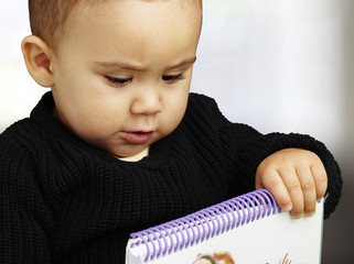 portrait of kid holding notebook indoor