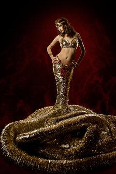 Beautiful woman in fantasy dress. Snake fashion dress stylish. A