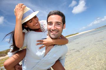 Lovers enjoying sunny day at the beach.