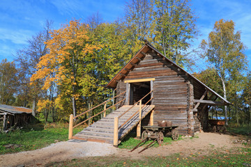 rural stable in autumn grove