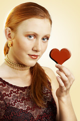 Young woman with a red heart