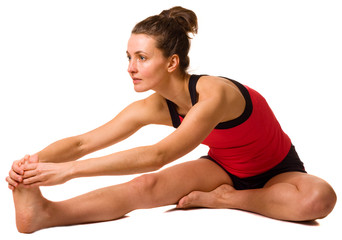 young woman stretching isolated on a white background.