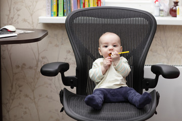 Baby on office chair