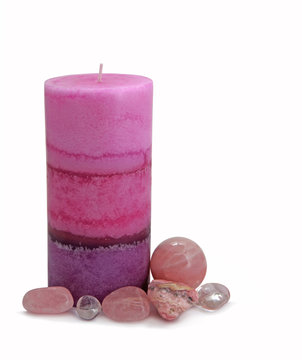 Candle surrounded by healing crystals