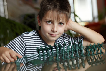 Young boy playing with toy soldiers