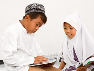 Muslim Children Reading Koran
