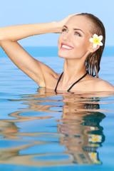 Adorable girl in the swiming pool
