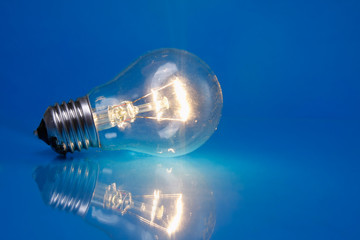 A light bulb isolated on blue background