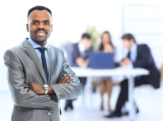 Happy african-american businessman with his team
