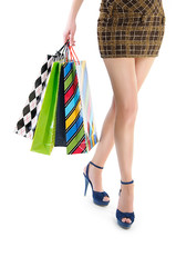 Woman holding shopping bags against white