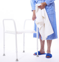 lower bodypart of handicapped old female using a shower seat