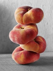 Stacked saturn peaches