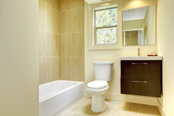 Wall Mural - New modern yellow bathroom with beige tiles.