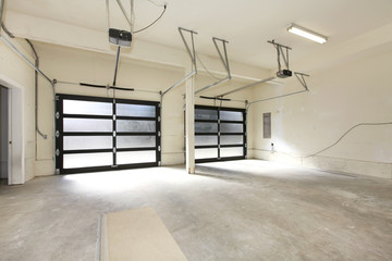 New two car garage with glass doors.