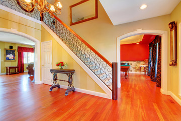 Large hallway with gold and red walls.