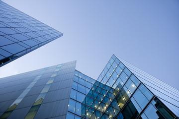 Foto op Canvas Aan het plafond Blue glass buildingson blue sky