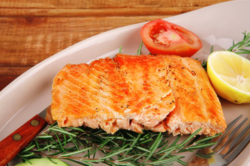 grilled salmon on glass plate
