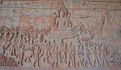 Thai traditional culture on stone wall