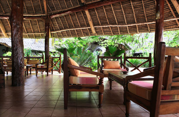 Beautiful resort with chairs, table and exotic trees