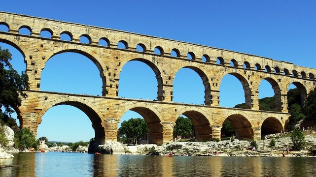 View from the river of Roman waterworks Pont Du Gard
