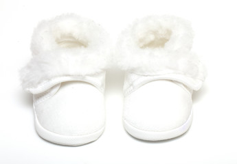pair of white baby boots