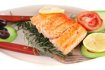 hot baked salmon piece served with vegetables