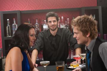 Bartender behind the bar friends having drink