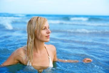 girl swims in sea