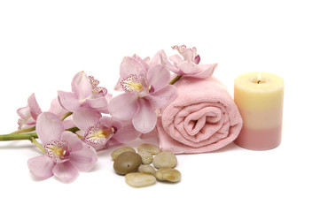 Spa concept with pink orchid, candle, towel, pebble
