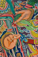 Fragment of God painting in traditional Chinese style on temple