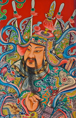 God painting in traditional Chinese style on temple door