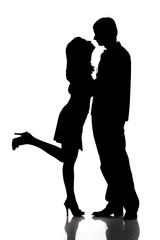 Silhouette of kissing happy couple as logo.