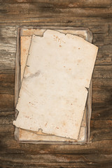 Aged papers on wood