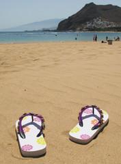 Flip-flops on the sand. Tenerife island, Canaries