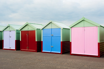 Brighton UK four beach huts right look