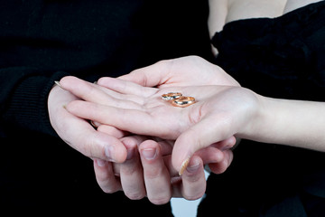 Rings in the hands of the newlyweds