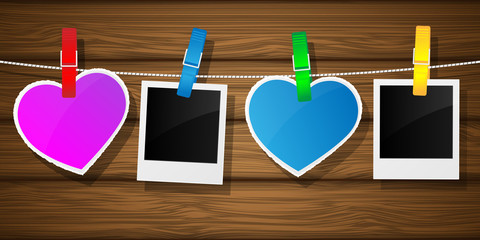 Photo frame and hearts on clothesline. Vector illustration.