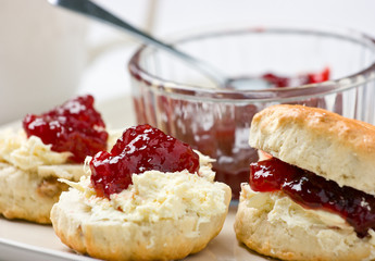 Home-baked scones with strawberry jam and clotted cream.