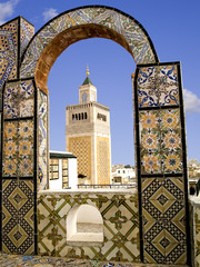 Door stickers Tunisia Mosque minaret framed by a tiled arch in Tunis city, Tunisia