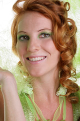 friendly smiling woman with red hair in green outfit