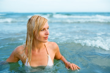 young woman floating in the sea