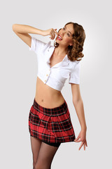Young pretty woman dressed in retro style