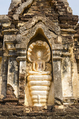 The Buddha statue top of pagodas on Temple. Sukhothai Historical