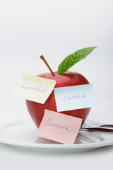 Apple with paper notes