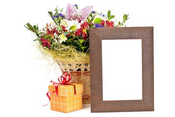 Gift box and wooden picture frame with flowers on white backgrou