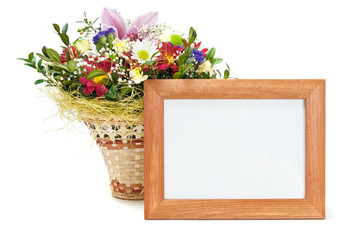 Wooden picture frame with flowers on white background