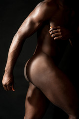 Cropped image of a nude african man