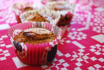 Freshly baked homemade muffins made with carrots and almonds