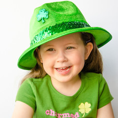 Pretty little girl dressed in green celebrates St. Patrick's Day