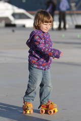 young girl roller skating